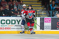KELOWNA, CANADA - NOVEMBER 7: Lucas Johansen #7 of Kelowna Rockets checks Riley Whittingham #25 of Spokane Chiefs at the board son November 7, 2014 at Prospera Place in Kelowna, British Columbia, Canada.  (Photo by Marissa Baecker/Shoot the Breeze)  *** Local Caption *** Lucas Johansen; Riley Whittingham;