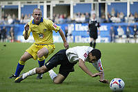 Photo: Marc Atkins.<br />Luton Town v Leeds United. Coca Cola Championship. 21/10/2006. Stephen Crainey of Leeds (L) brings down Carlos Edwards of Luton.