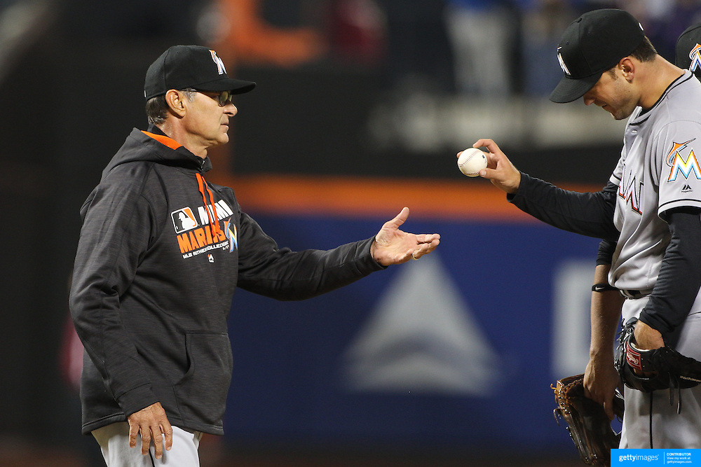 NEW YORK, NEW YORK - APRIL 11: Pitcher Jarred Cosart, Miami Marlins, is removed from the mound by manager Don Mattingly during the Miami Marlins Vs New York Mets MLB regular season ball game at Citi Field on April 11, 2016 in New York City. (Photo by Tim Clayton/Corbis via Getty Images)