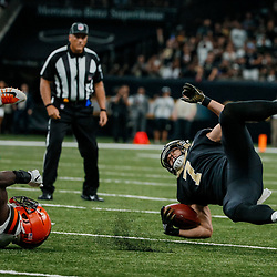 Sep 16, 2018; New Orleans, LA, USA; New Orleans Saints specialist Taysom Hill (7) is upended by Cleveland Browns safety Derrick Kindred (26) on a kickoff return during the third quarter of a game against the Cleveland Browns at the Mercedes-Benz Superdome. The Saints defeated the Browns 21-18. Mandatory Credit: Derick E. Hingle-USA TODAY Sports