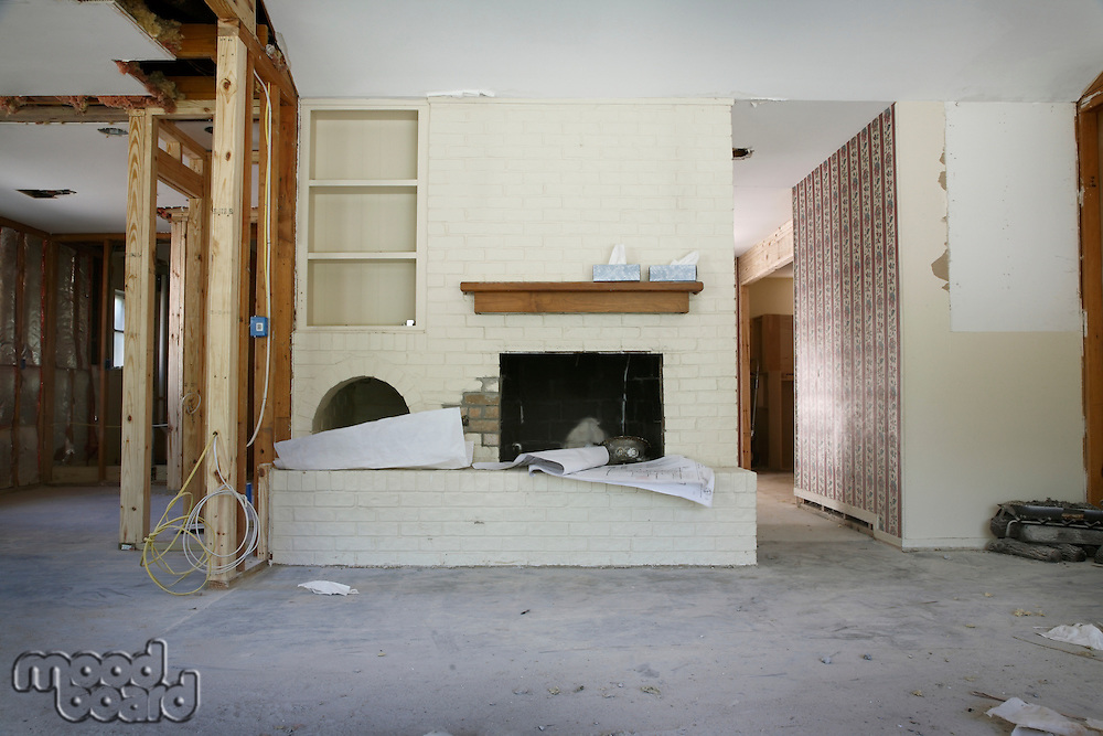 Brick fireplace and shelving in house renovation Houston Texas
