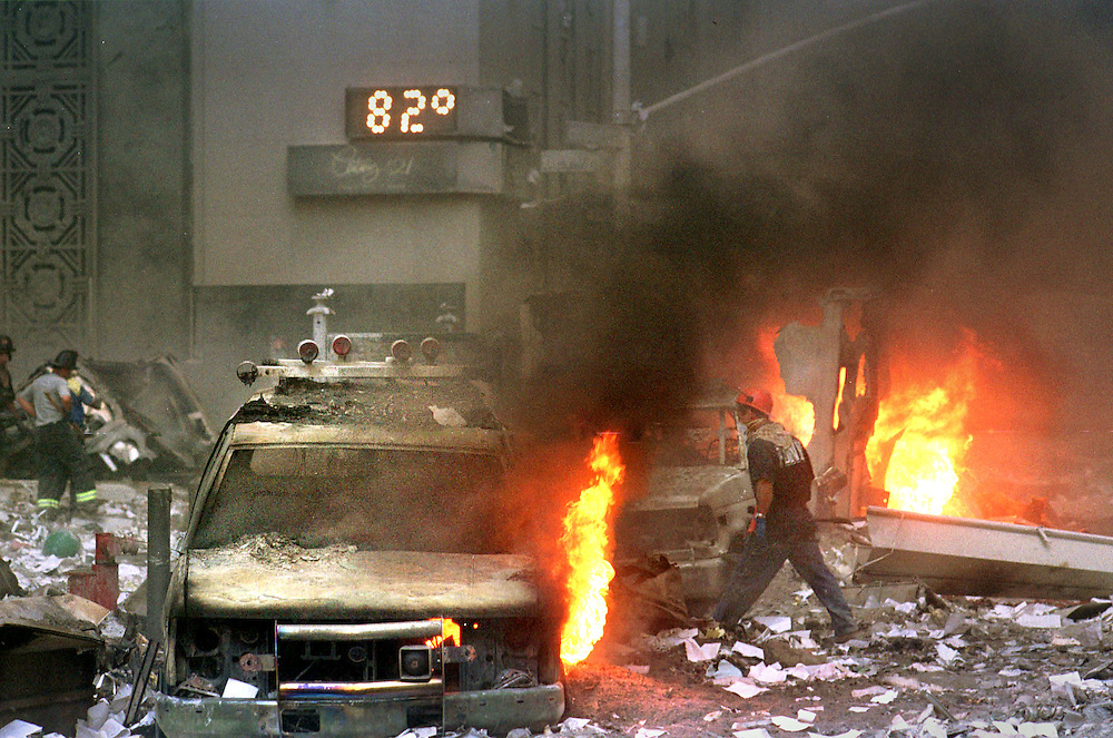 World Trade Center two hours after being struck by terrorists New York by Neville Elder no repro without permission call: 00 1 917 753 7529