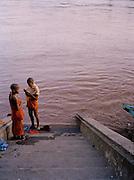 Novice monks bathing in the Mekong River.