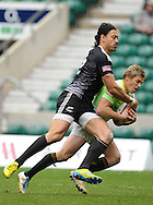 LONDON, ENGLAND - Sunday 11 May 2014, Ben Lam of New Zealand tackles Mark Richards of South Africa during the Cup quarter final match between South Africa and New Zealand at the Marriott London Sevens rugby tournament being held at Twickenham Rugby Stadium in London as part of the HSBC Sevens World Series.<br /> Photo by Roger Sedres/ImageSA