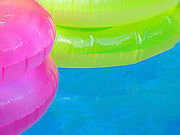 Colorful pool floats, detail.