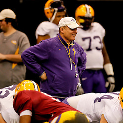 January 5, 2012; New Orleans, LA, USA; LSU Tigers head coach Les Miles watches over his team practice for the 2012 BCS National Championship game to be played on January 9, 2012 against the Alabama Crimson Tide at the Mercedes-Benz Superdome.  Mandatory Credit: Derick E. Hingle-US PRESSWIRE