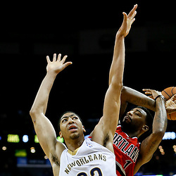Dec 30, 2013; New Orleans, LA, USA; New Orleans Pelicans power forward Anthony Davis (23) fouls Portland Trail Blazers small forward Dorell Wright (1) during the second half of a game at the New Orleans Arena. The Pelicans defeated the Trail Blazers 110-108. Mandatory Credit: Derick E. Hingle-USA TODAY Sports