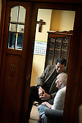 Belgium - Liege April 10, 2007, Priest is visiting a 93 year old and confused woman in nursing home ©Jean-Michel Clajot