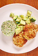 Seared crab cakes served with carolina gold rice and sauteed zucchini.