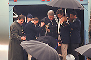 President Bill Clinton Suffering a torn ligament in his right knee is carried off Air Force One at Andrews Air Force base, MD March 14, 1997. The president's injury came during a visit to the home of golf pro Greg Norman in Hobe Sound, Fla.