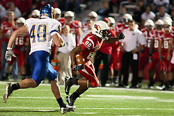 26 September 2009: Chase Douglas drops to the ground and Dirk Kool picks up the pursuit ofTyrone Walker in a game which the South Dakota State Jackrabitts jump past the Illinois State Redbirds 38 - 17 at Hancock Stadium on campus of Illinois State University in Normal Illinois