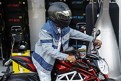 May 23, 2018 - Montecarlo, Monaco - 44 Lewis Hamilton from Great Britain Mercedes W09 Hybrid EQ Power+ team Mercedes GP with his MV Agusta motorbike during the Monaco Formula One Grand Prix  at Monaco on 23th of May, 2018 in Montecarlo, Monaco. (Credit Image: © Xavier Bonilla/NurPhoto via ZUMA Press)