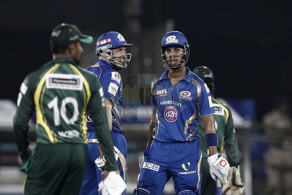 Michael Hussey talk with Lendl Simmons of the Mumbai Indians during the qualifier 4 match of the Oppo Champions League Twenty20 between the Mumbai Indians and the Southern Express held at the Chhattisgarh International Cricket Stadium, Raipur, India on the 14th September 2014<br /> <br /> Photo by:  Deepak Malik / Sportzpics/ CLT20<br /> <br /> <br /> Image use is subject to the terms and conditions as laid out by the BCCI/ CLT20.  The terms and conditions can be downloaded here:<br /> <br /> http://sportzpics.photoshelter.com/gallery/CLT20-Image-Terms-and-Conditions-2014/G0000IfNJn535VPU/C0000QhhKadWcjYs