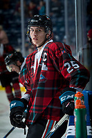 KELOWNA, CANADA - MARCH 10:  Cal Foote #25 of the Kelowna Rockets stands at the boards during warm up against the Kamloops Blazers on March 10, 2018 at Prospera Place in Kelowna, British Columbia, Canada.  (Photo by Marissa Baecker/Shoot the Breeze)  *** Local Caption ***