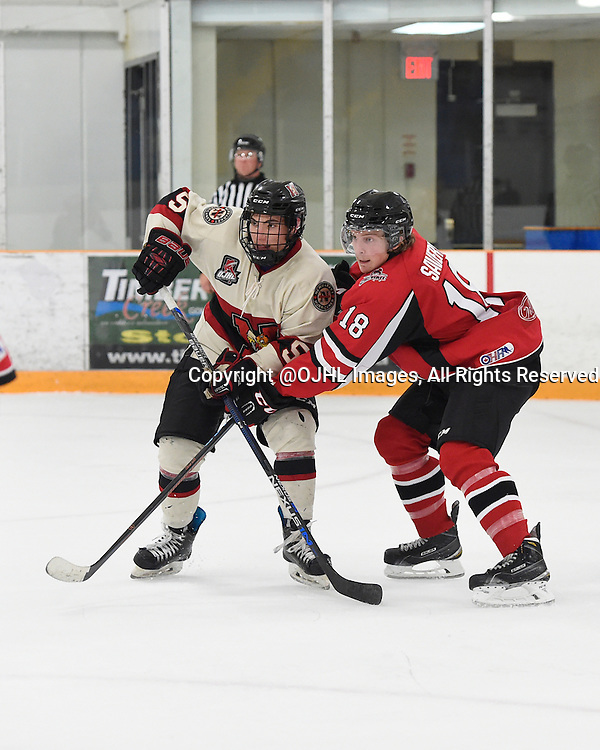 STOUFFVILLE, ON - Oct 12, 2015 : Ontario Junior Hockey League game action between Newmarket and Stouffville, Andrew Breda #5 of the Newmarket Hurricanes battles for the puck with Jackson Savery #18 of the Stouffville Spirit during the third period.<br /> (Photo by Andy Corneau / OJHL Images)