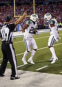 NFL side judge Alex Kemp (55) points indicating a turnover as New York Jets cornerback Marcus Williams (20) celebrates with New York Jets free safety Marcus Gilchrist (21) after Williams intercepts a fourth quarter pass by the Buffalo Bills and stops a potential scoring drive during the 2016 NFL week 2 regular season football game against the against the Buffalo Bills on Thursday, Sept. 15, 2016 in Orchard Park, N.Y. The Jets won the game 37-31. (©Paul Anthony Spinelli)