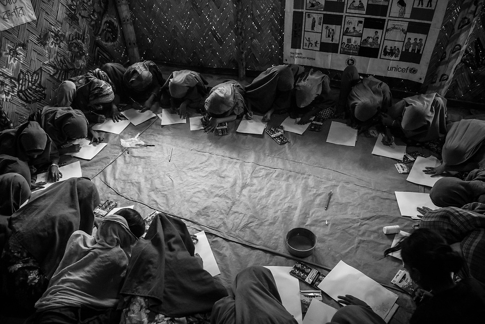 Rohingya girls draw at a CFS (Child Friendly Space) in Shamlapur refugee camp, Bangladesh. (October 30, 2017)