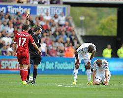 West Bromwich Albion's Graham Dorrans gets booked after a tackle on Swansea City's Jordi Amat - Photo mandatory by-line: Alex James/JMP - Mobile: 07966 386802 30/08/2014 - SPORT - FOOTBALL - Swansea - Liberty Stadium - Swansea City v West Brom - Barclays Premier League