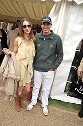 ADOLFO CAMBIASO and his wife MARIA VAZQUEZ at a charity polo match organised by Jaeger Le Coultre was held at Ham Polo Club, Richmond, Surrey on 12th June 2009.