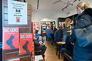 Rockville Centre, New York, USA. April 201, 2018. On display at Turn of the Corkscrew Books & Wine store are copies of Rep. Steve Israel's newest novel BIG GUNS and a flyer with information about the special event about to start there for Nassau County debut of the former Congressman's (NY - Dem) book. BIG GUNS is a satire of the strong gun lobby, weak Congress, and a small Long Island town.