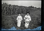 little children in kimono standing a corn field Japan ca 1940s