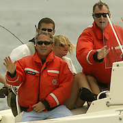 President Bush, left, daughter Jenna Bush, center, and former President George H. W. Bush, right, cruise on the family boat 'Fidelity II' during a fishing expedition near the family home Sunday, July 7, 2002, in Kennebunkport, Maine.  President Bush is spending the Independence Day weekend in Kennebunkport, Maine, home of his parents...Photo by Khue Bui