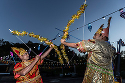 The Lord Provost of Edinburgh, Frank Ross, unveils the Sharing the Ramayana: The story of Diwali, an exhibition of 15 stunning illuminated Indian puppetry tableaux.<br /> <br /> Pictured: Participants in the Edinburgh Diwali celebrations