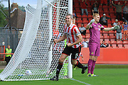 Aaron Downes celebrates the opening goal during the Vanarama National League match between Cheltenham Town and Southport at Whaddon Road, Cheltenham, England on 15 August 2015. Photo by Antony Thompson.