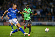 AFC Wimbledon forward Michael Folvi (17) tussles with Ipswich Town defender Luke Woolfenden (28) during the EFL Sky Bet League 1 match between Ipswich Town and AFC Wimbledon at Portman Road, Ipswich, England on 20 August 2019.