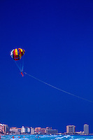 Parasailing over the Caribbean Sea off Cancun, Mexico