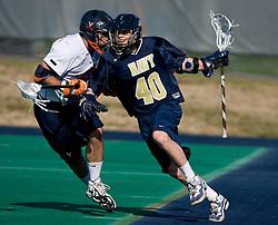 Navy attackman Nick Mirabito (40) takes on Virginia defenseman Ryan Nizolek (24).  The Virginia Cavaliers scrimmaged the Navy Midshipmen in lacrosse at the University Hall Turf Field  in Charlottesville, VA on February 2, 2008.