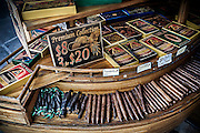 In Key West it's not hard to find a cigar. Most purport to be made with Cuban tobacco. All along and just off of Duval St. you can find cubbyholes where cigar vendors have set up shop. This particular vendor made use of some iconic Key West images for their boxes.