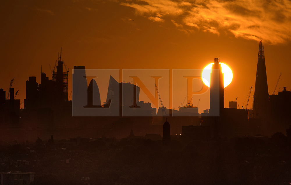© Licensed to London News Pictures. 21/06/2018. London, UK. The summer solstice sun rises behind St George Wharf Tower in Vauxhall at the start of the longest day of the year. A period of hot and sunny weather is forecast for much of the UK over the next 10 days. Photo credit: Peter Macdiarmid/LNP