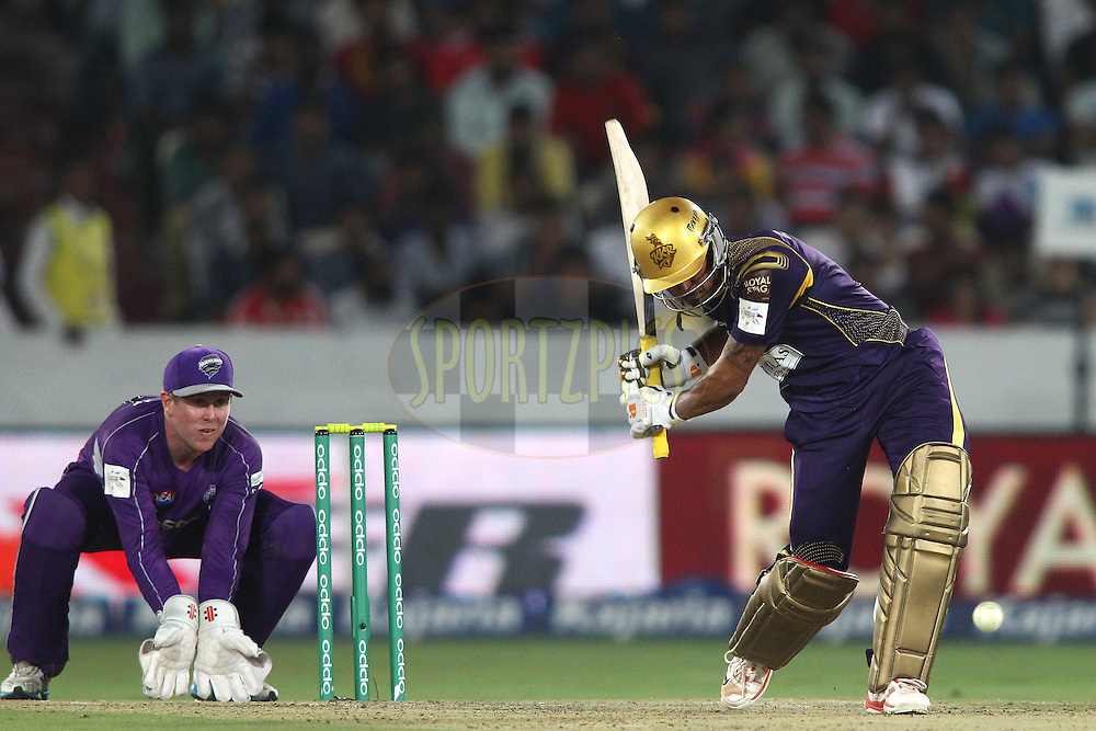 Manish Pandey of the Kolkata Knight Riders moves down the track to a delivery during the first semi final match of the Oppo Champions League Twenty20 between the Kolkata Knight Riders and the Hobart Hurricanes held at the Rajiv Gandhi Cricket Stadium, Hyderabad, India on the 2nd October 2014<br /> <br /> Photo by:  Shaun Roy / Sportzpics/ CLT20<br /> <br /> <br /> Image use is subject to the terms and conditions as laid out by the BCCI/ CLT20.  The terms and conditions can be downloaded here:<br /> <br /> http://sportzpics.photoshelter.com/gallery/CLT20-Image-Terms-and-Conditions-2014/G0000IfNJn535VPU/C0000QhhKadWcjYs