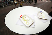 empty RAW herring paper plates with shopped unions and Dutch little paper flags
