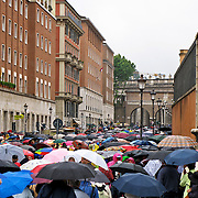 People under a sea of umbrellas outside Vatican and Piazza S. Pietro on Via della Conciliazione, Rome, Italy
