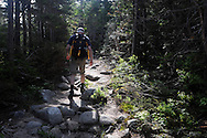 John Walcott walks along the Chimney Pond Trail in Baxter State Park.  He travelled to Maine, as he has done since 1976, to summit Mt Katahdin, the highest point in Maine and the northern terminus of the Appalachian Trail as a 60th birthday celebration.