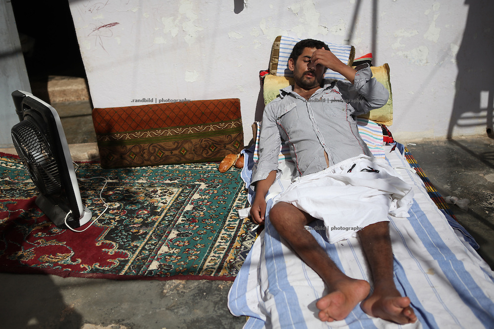 Jafar was beeing hit by bullet during a demonstration in May 2011 near Mastuma. He roghly survived and since he can´t move his legs his family tries to treat him at home in Courine. Courine was been attacked by ground troops on February 22, 2012 (see archive images). aftermath air force helicopters shot  rockets several times into the 7000 inhabitants counting village south of Idlib city. Courine ist still a stronghold of opposition.