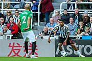 Bruno Saltor (#2) of Brighton & Hove Albion watches as Kenedy (#15) of Newcastle United controls the ball during the Premier League match between Newcastle United and Brighton and Hove Albion at St. James's Park, Newcastle, England on 20 October 2018.