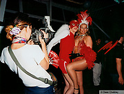 Girl wearing go go dancers outfit, boy wearing red feather mask and ahgel wings, Ibiza, 2000