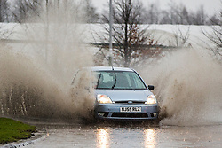 © Licensed to London News Pictures. 10/04/2018. Leeds UK. Drivers hit large patches of standing water this morning in Garforth near Leeds after heavy rainfall. Photo credit: Andrew McCaren/LNP