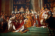 'The Coronation of Napoleon' painting completed in 1807 by Jacques-Louis David, the official painter of Napoleon. The painting has imposing dimensions, as it is almost ten metres wide by approximately six metres tall. The crowning and the coronation took place at Notre-Dame de Paris, a way for Napoleon to make it clear that he was a son of the Revolution.