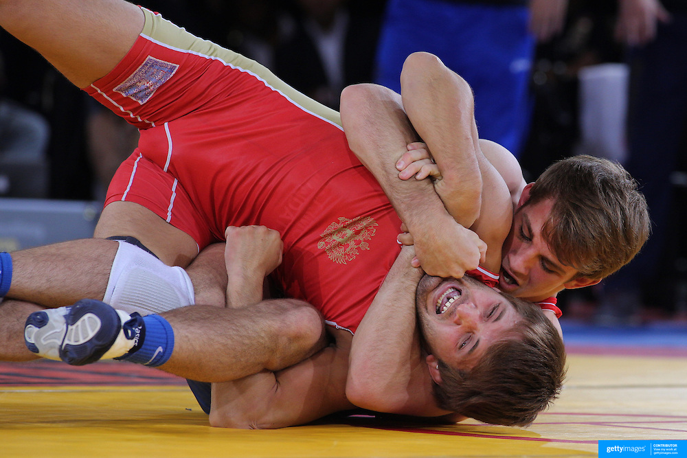 David Taylor, USA, (blue) in action against, Magomed Kurbanaliyev, Russia, (red) as wrestlers from USA, Iran and Russia compete at Grand Central Terminal as part of the Beat the Streets Gala. Billed ?The Rumble On The Rails,? the international wrestling event showcased competition as part of World Wrestling Month. Vanderbilt Hall, Grand Central Station, Manhattan,New York. USA. 15th May 2013. Photo Tim Clayton