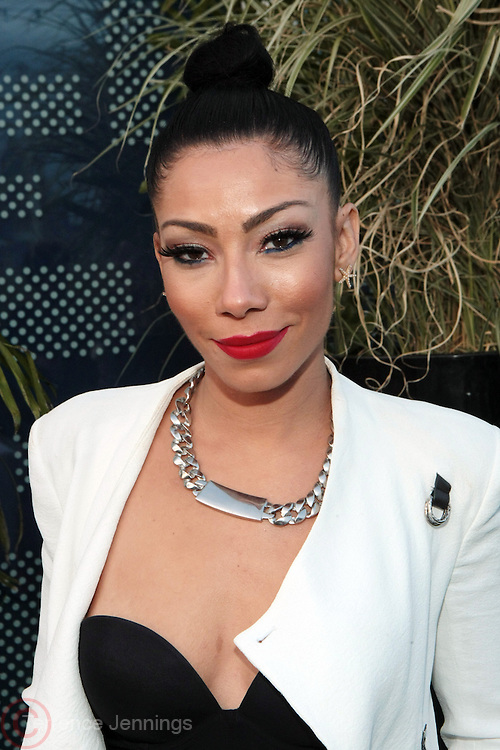 "9 September 2013- New York, NY: Recording Artist Bridget Kelly attends the "" Hair Icon '  Cocktail & Dinner party presented by Beautiful Textures in partnership with BET Networks and Cadillac held at the Mondrian Soho Penthouse on September 9, 2013 in New York City. ©Terrence Jennings"