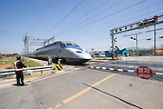 Railway crossing near Hamyeol. A KTX (Korea Train Express) high speed train (a license of French TGV) going from Kwangju to Seoul.