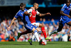 Theo Walcott of Arsenal is tackled by Gary Cahill of Chelsea - Mandatory byline: Rogan Thomson/JMP - 07966 386802 - 19/09/2015 - FOOTBALL - Stamford Bridge Stadium - London, England - Chelsea v Arsenal - Barclays Premier League.