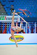 Halkina Katsiaryna during qualifying at ribbon in Pesaro World Cup 11 April 2015.   Katsiaryna is a Belarusian rhythmic gymnastics athlete born  February 25, 1997 in Minks, Belarus.