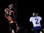 28 Oct. 2011 -- WEBSTER GROVES, Mo. -- Webster Groves High School wide receiver Demetrius Robinson (81) reaches high to catch a touchdown pass over Parkway North High School defender Nathan Tilson (2) to score the first touchdown for the Statesmen during the football game between the schools at Moss Field in Wester Groves, Mo. Friday, Oct. 28, 2011. Photo © copyright 2011 Sid Hastings.