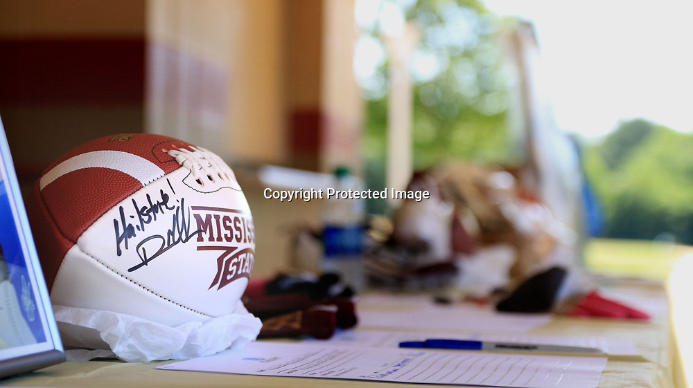 AARON STEWART || BUY AT PHOTOS.DJO<br /> A Dan Mullen autographed football sits at the silent auction table at the All-Star Football Camp benefiting the Boys and Girls Club Saturday Morning.