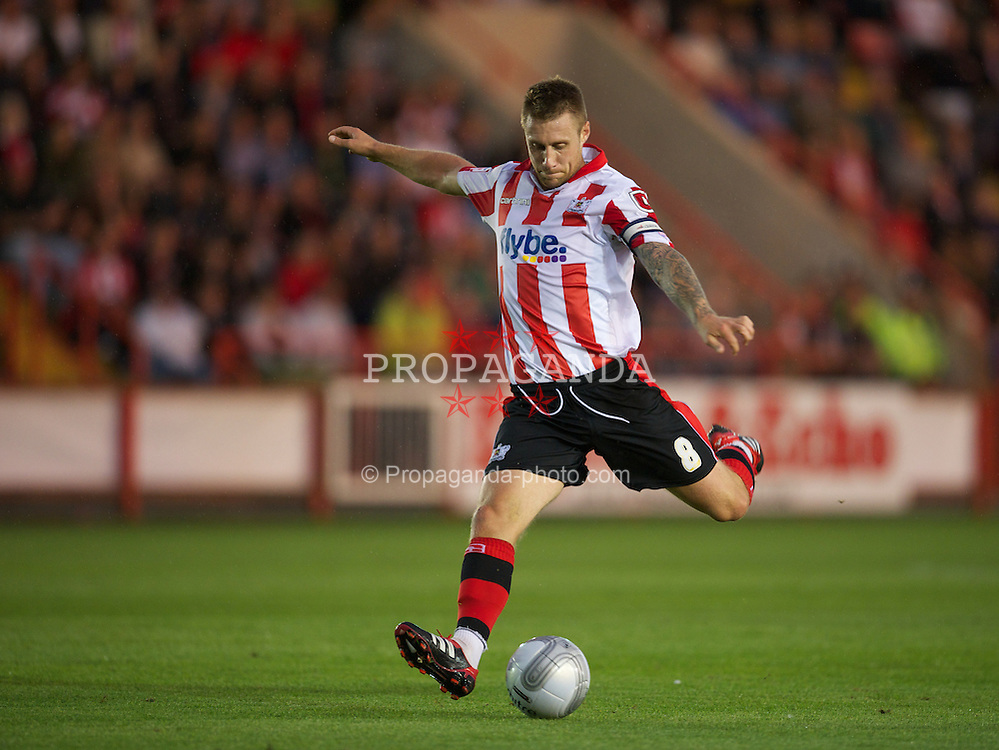 EXETER, ENGLAND - Wednesday, August 24, 2011: Exeter City's David Noble in action against Liverpool during the Football League Cup 2nd Round match at St James Park. (Pic by David Rawcliffe/Propaganda)